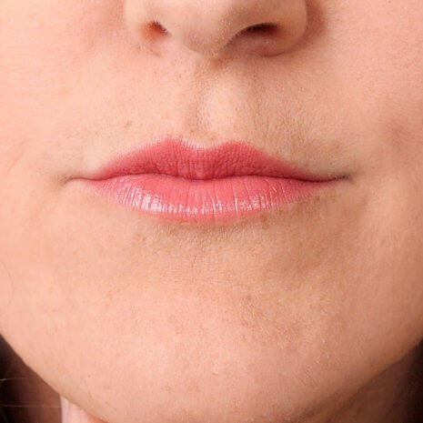 Close up Image of Andrea's Lips in neutral pink lipstick by Red Apple Lipstick