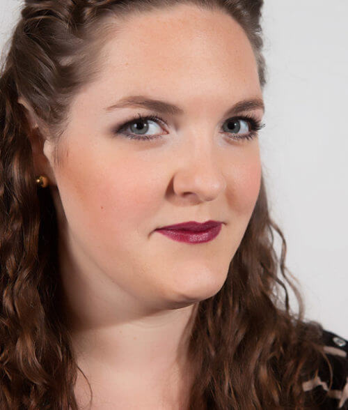 Andrea wearing the Safe red wine colored Fierce lipstick