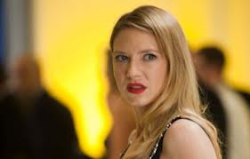 Olivia Dunham  in blonde hair and bright lipstick