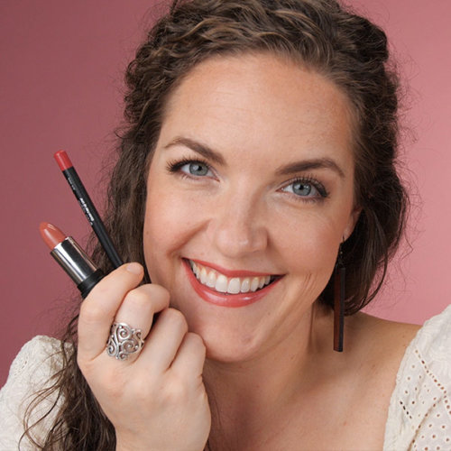 Image of RAL Founder Andrea wearing and holding Gluten Free Makeup from RAL