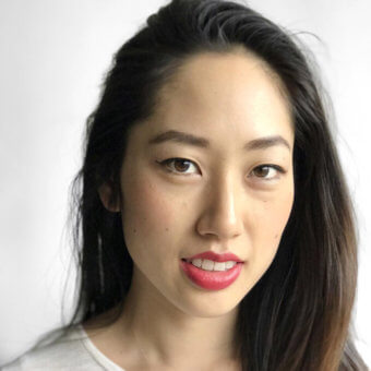 image of asian woman with light neutral skin wearing bold pink lipstick in unpinkable