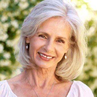 Smiling mature woman wearing lipstick