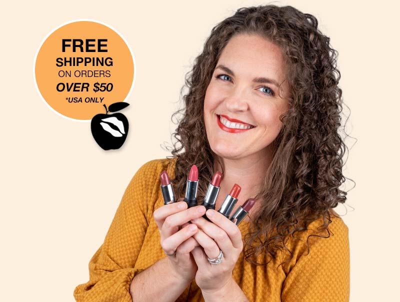 smiling woman wearing gluten free hypo allergenic lipstick