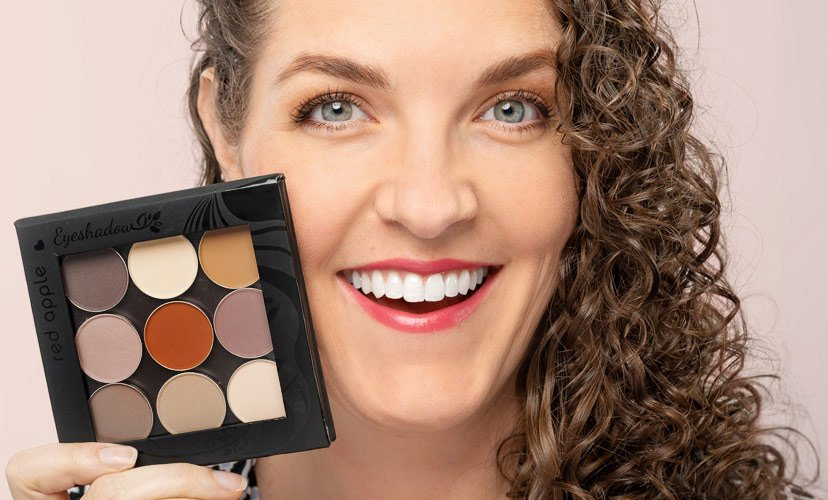 Picture of Andrea holding a gluten free eyeshadow matte makeup palette