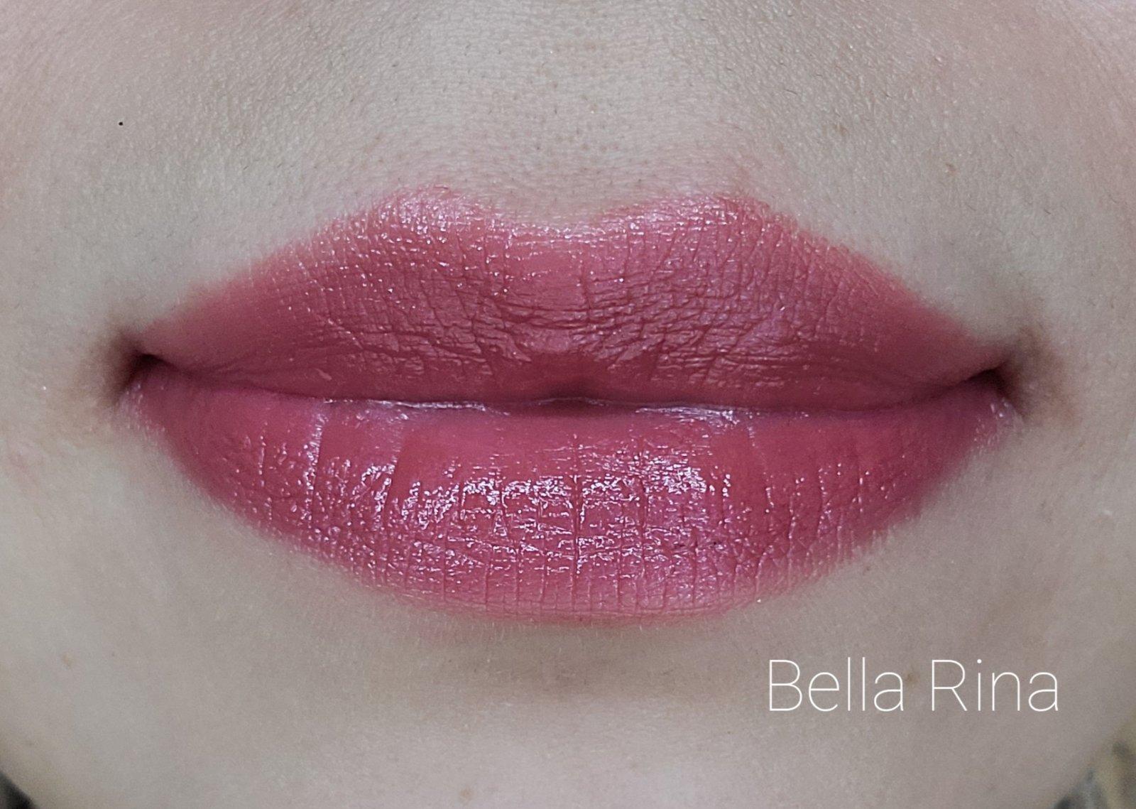 Image of close up lips wearing the shade called Bella Rina. A warm medium pink.