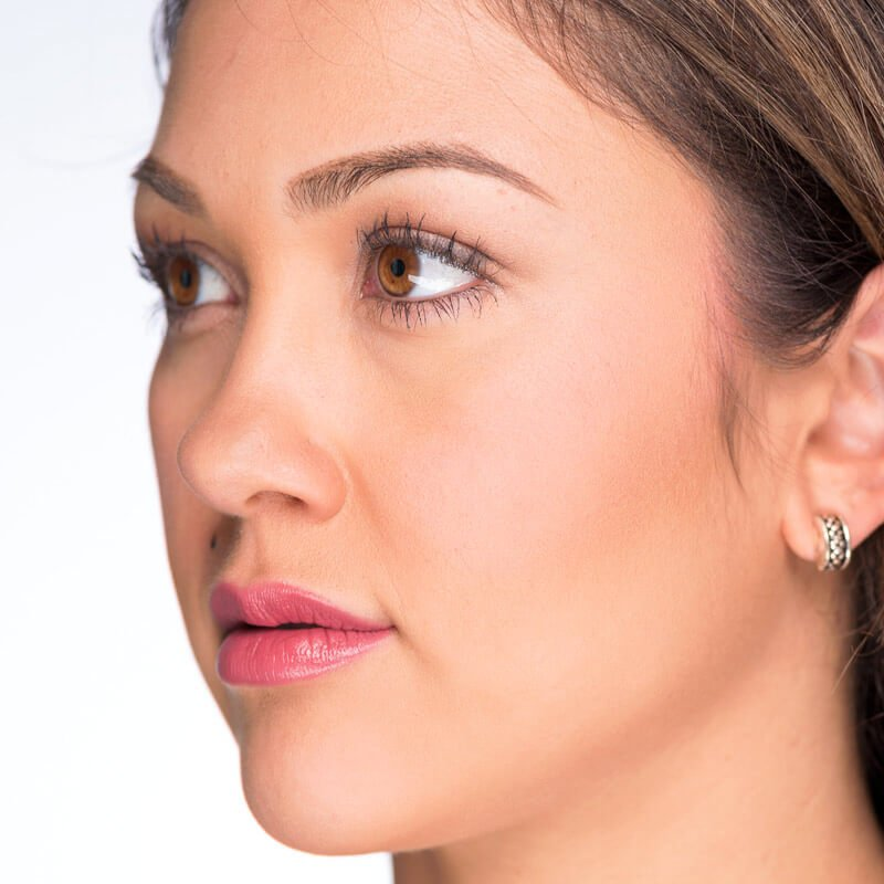 Image of women with medium skin tone and brown hair with golden highlights wearing Kissimmee Lipstick by Red Apple Red Lipstick. Kissimmee is a Kissimmee is a perfect balance between pink and red.