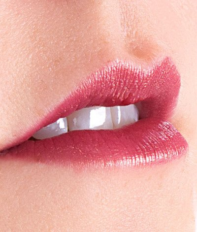 Image of a lady's close up lip wearing Plum Sexy Crazy lipstick. She has light skin tone.  Plum Sexy Crazy is a deep, multi-dimensional red plum color with a golden shimmer.