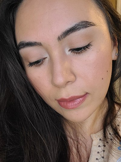 Image of lady with medium complexion, long black hair and dark eyes. She is slightly looking downward and she is featured wearing Chai Love You lipstick by Red Apple Lipstick. Chai Love You is  a nude shade with a reddish-brown undertone, a good choice for medium to  olive complexions.