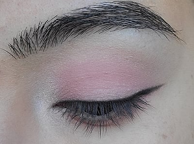 Image of eyelid with Black Magic Eyeshadow used as an eyeliner with a small wing on the outer corner edge