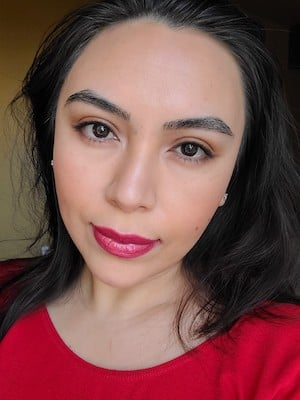 Image of model Noemi wearing Red Apple Lipstick products to demonstrate date night makeup.