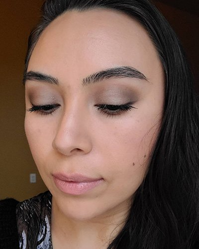 Image of female with black hair wearing Red Apple Lipstick Eyeshadows in the shades Porcelain , Earth Girl, Tip Taupe, Champagne, Buttercream and Hello Darkness as an eye liner. She is also wearing Sundrop Bronzer and Gotta Glow blush on her cheeks.