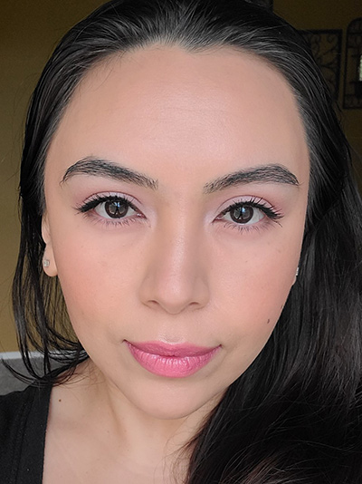 Image of female with black hair, dark brown eyes wearing Red Apple Lipstick's Lipstick in the shade called Mabel