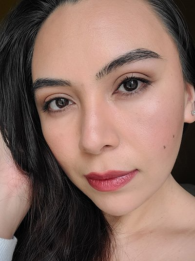 Image of Female with long black hair, dark brown eyes wearing Red Apple Lipstick's Lipstick in the shade called Strawberry Lips