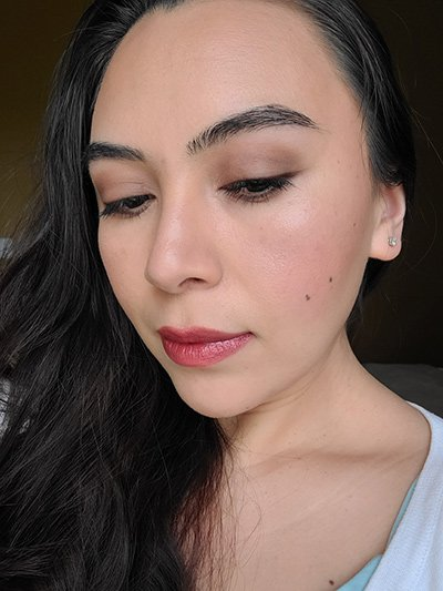Image of female with long black hair wearing Red Apple Lipstick Eyeshadow in the shades Porcelain, Blondeshell, Tip Taupe, and Espresso. The Lash Project Mascara, Sundrop Bronzer, Coy Blush and Barely Pink Lip Liner