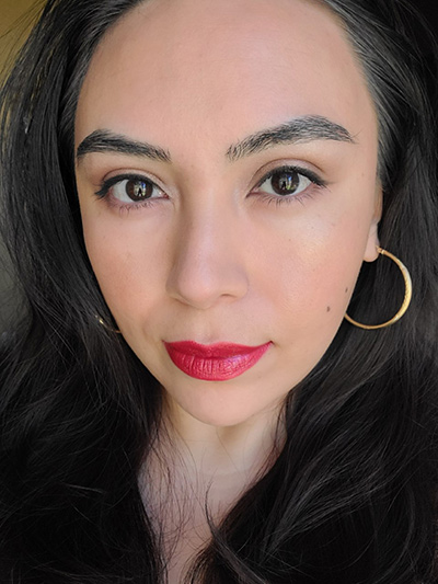 Image of female with long black hair, dark brown eyes wearing Red Apple Lipstick Eyeshadows in the shades Buttercream, Bronze Bombshell, Yes You Canyon, and Sand Castle. Black Eyeliner Pencil, The Lash Project Mascara. On her face and cheeks she is wearing Sundrop bronzer and Coy Blush