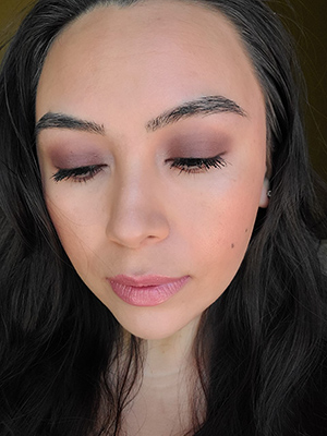 Image of lady with long black hair looking down to show all the eyeshadow colors that she used to complete the Smokey Eye look