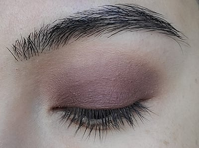 Image of close up eye lid after Hush Hush Eyeshadow by Red Apple Lipstick has been applied onto the edges of Made You Wink eyeshadow and blended out.