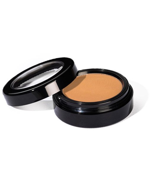 Image of Sundrop Bronzer by Red Apple Lipstick. Shown with top of compact open laying to the side and the color of the material seen.