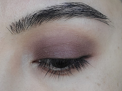 Image of close up eyelid after Buttercream eyeshadow has been applied as a highlight to the upper brow bone and the inner corner of the eye close to the tear duct.