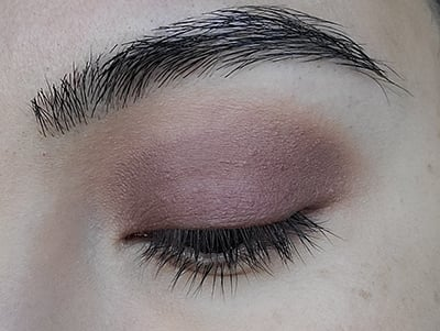 Image of close up eye lid after Made You Wink eyeshadow by Red Apple Lipstick has been applied to the transition area above the crease and blended out.