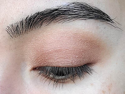 Image of close up eyelid after Sugar & Spice eyeshadow by Red Apple Lipstick has been applied.