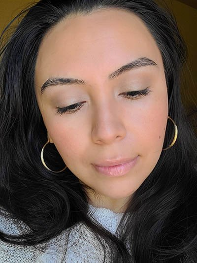 Image of lady with long dark hair, dark eyes and brows with medium skin tone. She is featured here after completing the Ethereal and Natural Summertime makeup look. All with Red Apple lipstick products.