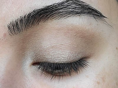 Image of close up eyelid with Innocence  eyeshadow by Red Apple Lipstick applied to the inner corner and brow bone for a soft highlight.