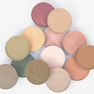 Image of some of Red Apple Lipstick's over 40+ eyeshadow pans in a variety of colors to choose from