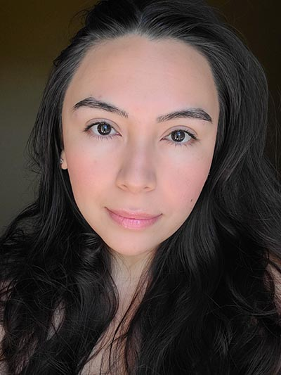 Image of lady with medium skin tone, long dark hair and dark eyes featured wearing only a bit of Sundrop Bronzer, Gotta Glow blush, Lash Project mascara, Rallye Balm, and Love Letter lipgloss