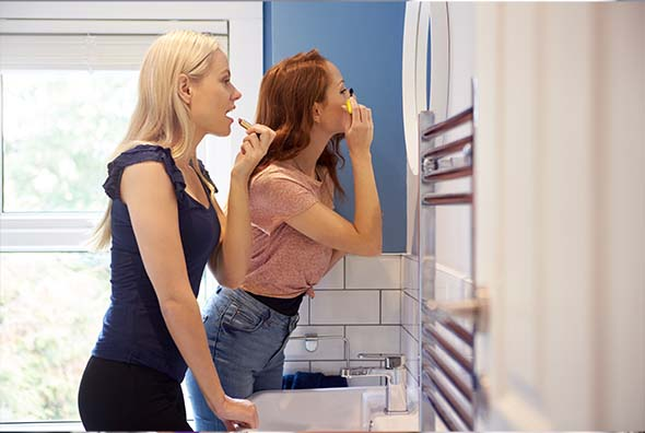 Image showing two women sharing makeup. It is a big no no when you are trying to improve your makeup's usage life and reduce skin issues.
